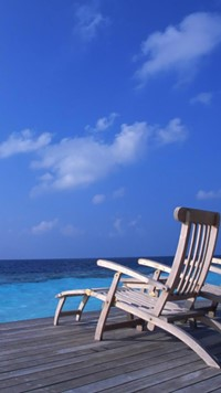 Champagne Beach with wooden chair wallpaper