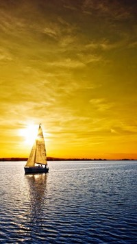 silent sea with boat and sun down wallpaper